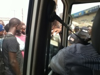 People crowd around our vehicle to see what is happening.