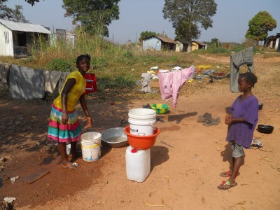 The children are doing daily chores.  The one girl was washing the dishes.